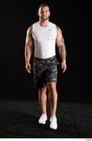 Grigory  1 camo shorts front view sports walking white sneakers white tank top whole body 0003.jpg